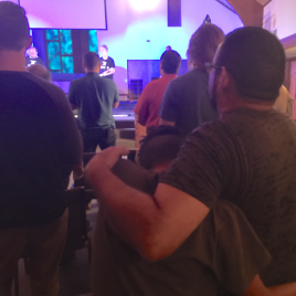 Father hugging son at church